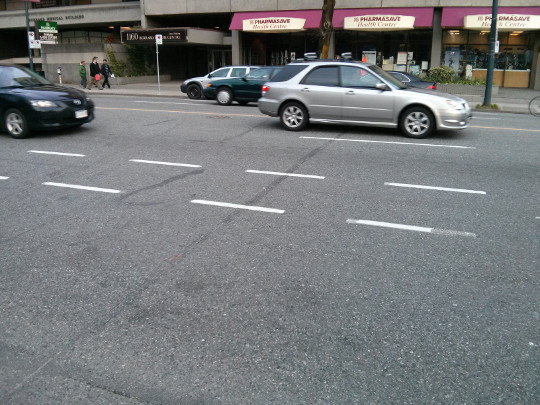 Surface Inlaid Fiber crossing Burrard St., darker line in centre of photo is concrete saw cut